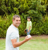 Son playing football with his father. Durring the summer Stock Photo