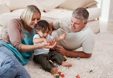 Son playing with his parents. At home royalty free stock photos