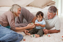 Son playing with his parents. At home stock photos