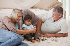 Son playing with his parents Royalty Free Stock Image