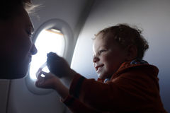 Son playing with mother. Son is playing with his mother at airplane Royalty Free Stock Images