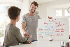 Son Receiving Pocket Money After Completing List Of Chores stock photos