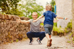 Son runs to daddy's arms Stock Photo