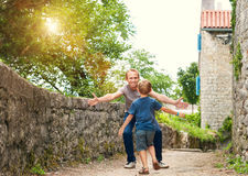 Son runs to his daddy hugs Stock Images