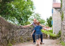 Son runs to his daddy hugs Stock Photo