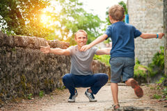 Son runs to his father hugs Stock Photos