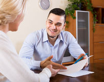 Son and senior mother with documents Royalty Free Stock Images