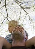 Son on shoulder Stock Photo