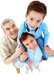Son on shoulder. A boy sitting on his father�s shoulders with a grandfather standing by them Royalty Free Stock Photography