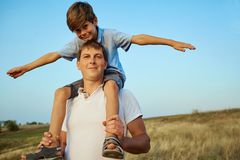 Son with father in the open air in the field. Stock Image