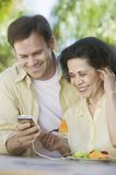 Son Showing Mother How to Use MP3 Player Stock Photo
