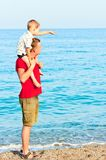 Son that it shows his father in sea Stock Image