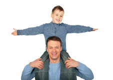 Son sits on father`s shoulders Royalty Free Stock Images