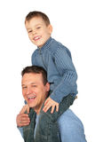 Son sits on father`s shoulders. View from side stock photography