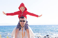 Son sitting on father's shoulders Stock Photo