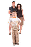 Son stands before parents Stock Photo