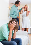 Son suffering of parents argue. Teenager son suffering of parents conflict at home Stock Photography