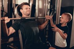 Son Support To Father While Lifting The Barbell. stock image