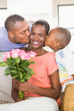 Son surprising mother with flowers Stock Photos
