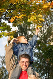 Son take autumn leaf Stock Photos