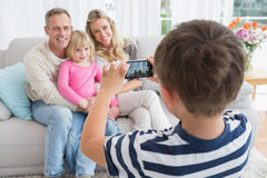 Son taking a photo of his family Royalty Free Stock Image