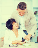 Son telling glad mother how to use phone. Son telling his glad mother how to use phone royalty free stock photo