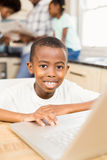 Son using laptop in the kitchen Royalty Free Stock Photos
