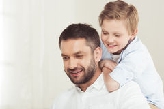 Son with young father spending time at home. Little son with young father spending time at home stock photos