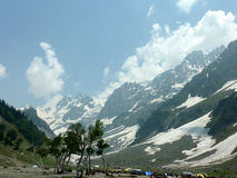 Sonamarg valley, Kashmir. With Thajwas glacier above, used for skying and sledging but often unstable and dangerous in ravines where it forms snow bridges over Stock Photo