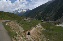 Sonamarg village scene. A beautiful landscape of a Kashmir with a snow peak and roads with a transport activity stock image