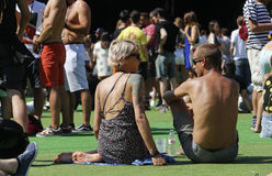 Sonar festival goers. Festival goers sit and lay on the ground next to scenery at sonar electronic music festival in Barcelona, spain Royalty Free Stock Image