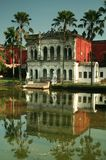 Sonargaon museum. An old indian architecture style building reflected in the water in sonargaon, bangladesh Stock Photo