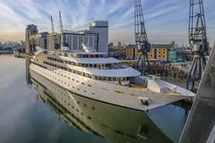 Sonborn Yacht hotel moored at Royal Victoria Dock, London. Royal Victoria Dock, London, uk - February 14, 2018: Sonborn Yacht hotel moored beside the dock with stock images