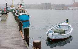 Sonderborg harbor (2), Denmark. Small fishing boats lie towed in the small harbor of Sonderborg, Denmark - a rowing boat in front Stock Photos