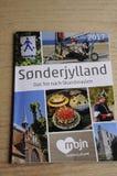 SONDERJYLLAND-KATALOG I TYSKLANDSPRÅK fotografering för bildbyråer
