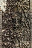 Sonderkommando von verwickelt geschnitztem Bas Relief im hindischen Tempel Stockbilder