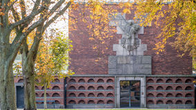 Sondermarken Crematorium. In Frederiksberg Denmark with a Sad 1930s style angel and Alpha and Omega above the entrance stock photos