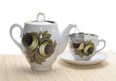 Sondern Sie Teekanne mit einem Cup aus lizenzfreies stockfoto