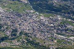 Sondrio aerial cityscape, Italy. Aerial shot, from a small plane, of Sondrio little town in Valtellina valley with river Adda flowing south of it, Lombardy royalty free stock images