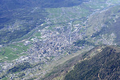 Sondrio cityscape from above, Italy. Aerial from north of Sondrio little town in Valtellina valley with river Adda flowing south of it, shot, from a small plane Stock Photography
