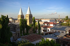 Sone town cathedral rooftop. Stone town zanzibar rooftop view over town with cathedral towers in sight royalty free stock images