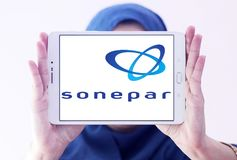 Sonepar company logo. Logo of Sonepar company on samsung tablet holded by arab muslim woman. Sonepar is an independent family owned company with global market Stock Images