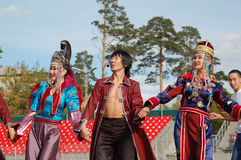 Song and dance company Baikal. ULAN-UDE, RUSSIA - SEPTEMBER 17: Artists of Baikal, the State Buryat song and dance company, perform in a show of Amarhuu Borhuu stock photo