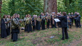 The song of the forest - Choir in the Woods Stock Image