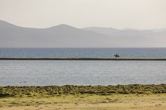 Song Kul lake in Kyrgyzstan in the evening light. Song Kul lake in Kyrgyzstan in the magic evening light stock photo