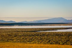 Song Kul lake, Kyrgyzstan. Song Kul lake in mist in early morning light, Kyrgyzstan Royalty Free Stock Image