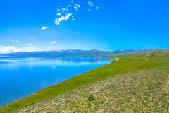 Song Kul Lake 20. Song Kul Lake View Point with Snow Capped Moldo Too Mountains Landscape royalty free stock photo