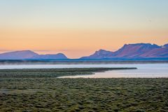 Song Kul lake in sunrise, Kyrgyzstan. Song Kul lake in mist in early morning light, Kyrgyzstan Stock Photos