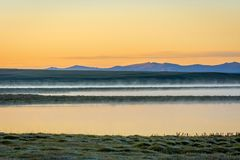 Song Kul lake in sunrise, Kyrgyzstan. Song Kul lake in mist in early morning light, Kyrgyzstan Stock Image