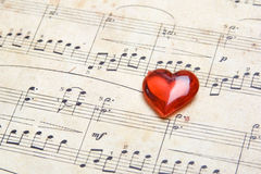 Song of love. Old a classical music they have a red heart. Valentine's day royalty free stock photo
